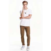 H&M Spodnie z diagonalu Slim fit 0411758009 Ciemnobeżowy