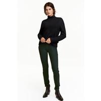 H&M Spodnie superstretch 0355953029 Ciemnozielony