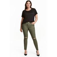 H&M H&M+ Elastyczne spodnie 0352811014 Zieleń khaki/Do kostki