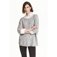 H&M Sweter robiony lewym ściegiem 0244267014 Czarny/Biały melanż