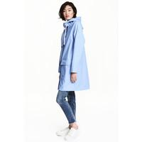 H&M Płaszcz przeciwdeszczowy 0477278002 Jasnoniebieski