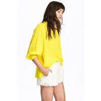 H&M Bluzka z dekoltem w serek 0500827004 Żółty